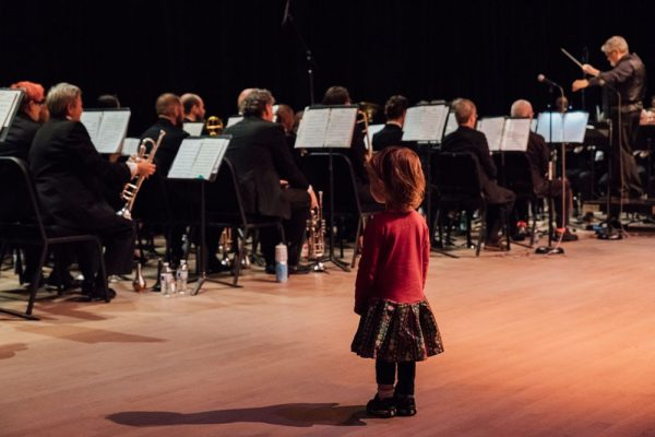A young audience member waits patiently for the Dance-Along Nutcracker show to begin