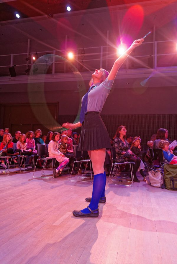 Dancer spins a hula hoop on one arm while waving a magic wand with the other at 2018 Dance-Along Nutcracker: Clara Potter and the Elder Baton