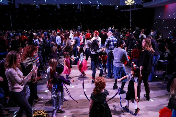 Children with streamers dance to a Nutcracker Suite song