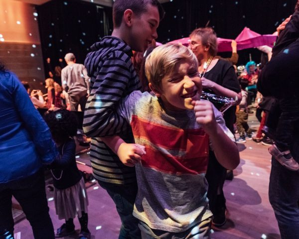 Boy smiles for the camera while dancing to Nutcracker Suite music
