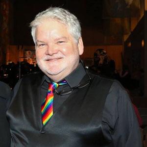 Artistic director Pete Nowlen wearing a rainbow tie