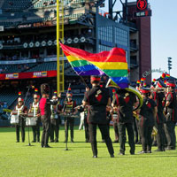 SF Lesbian/Gay Freedom Pep Band plays on the field at Oracle Park for LGBT Night with the Giants