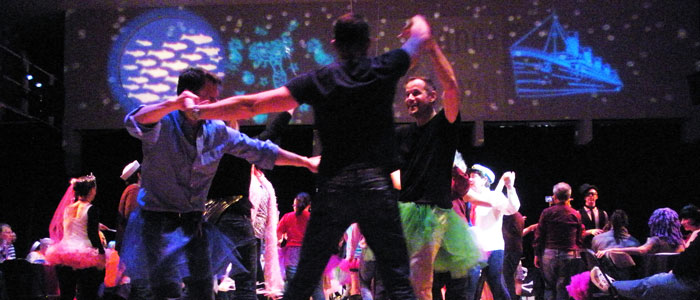 Adults wearing tutus are having fun at the Dance-Along Nutcracker
