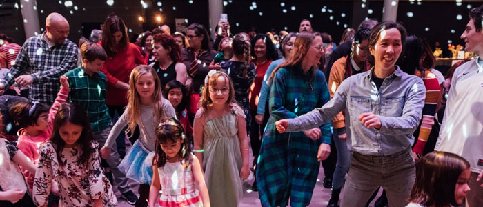 Audience members of all ages dancing to the Nutcracker Suite ballet music