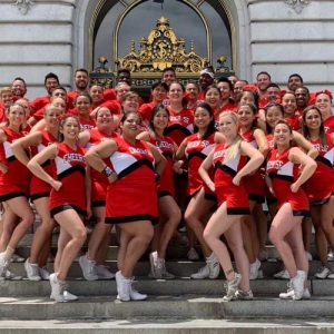 Group picture of Cheer SF in front of SF City Hall